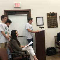 Eli Greenberg speaking to Olmos Park Mayor and City Council on behalf of Olmos Park Youth Commission with Sam Spezia-Lindner and Henry Satel waiting to speak.