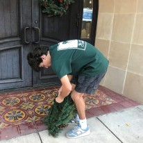 Henry Satel preparing wreath to adorn Olmos Park City Hall entrance