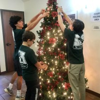 Pictured L-R Henry Satel, Miles Mazloum and brother, Bryce Mazloum decorating Olmos Park's Christmas Tree with new ornaments