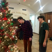 OPYC founders Sam Spezia-Lindner and Henry Satel admiring City Hall's new Christmas ornaments