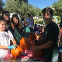 Nina Davidson, Emory Middleman, Ava Greenberg and Jack Henry Bullock help (and have fun!) at October pumpkin carving