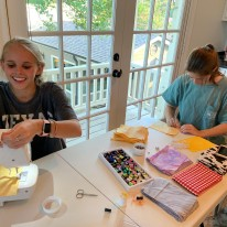 Lila Kelley and Brittin McBirnie )pictured) along with Ava Satel make masks for those in need during COVID-19